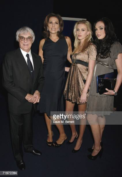 Bernie Ecclestone with wife Slavica Ecclestone and daughters Petra and Tamara attend the fashion show and party to celebrate the launch of Emporio...