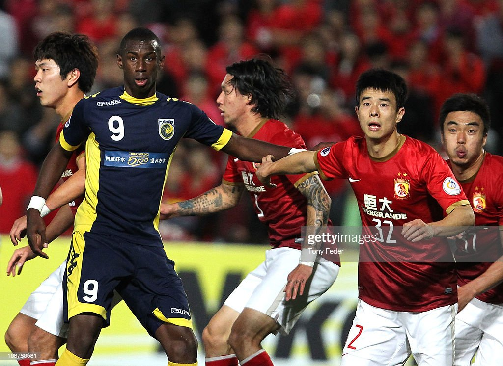 Bernie Ibini of the Mariners and Sun Xiang of Evergrande jostle in the goal mouth during the AFC Asian Champions League match between the Central Coast Mariners and Guangzhou Evergrande at Bluetongue Stadium on May 15, 2013 in Gosford, Australia.