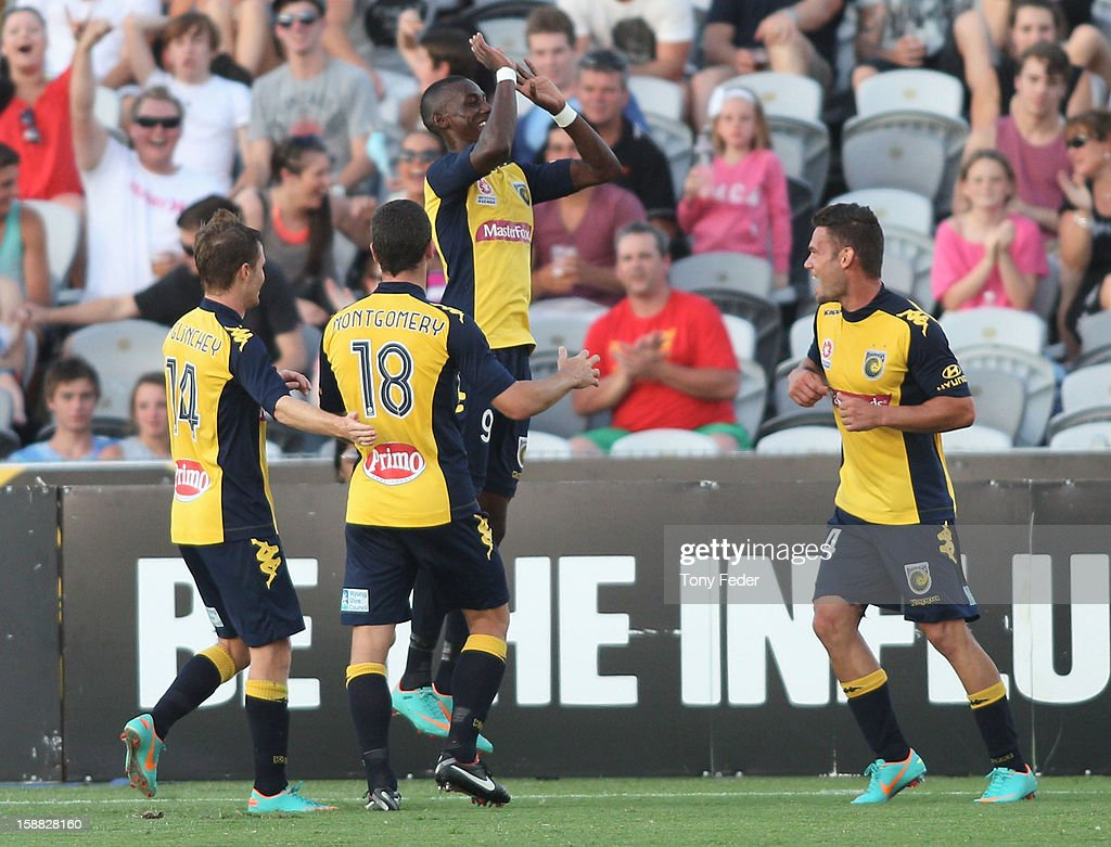 Bernie Ibini of the Mariners celebrates a goal with team mates during the round 14 A-League match between the Central Coast Mariners and the Perth Glory at Bluetongue Stadium on December 31, 2012 in Gosford, Australia.