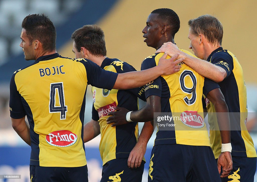 Bernie Ibini of the Mariners celebrates a goal with team mates during the round 20 A-League match between the Central Coast Mariners and the Wellington Phoenix at Bluetongue Stadium on February 7, 2013 in Gosford, Australia.