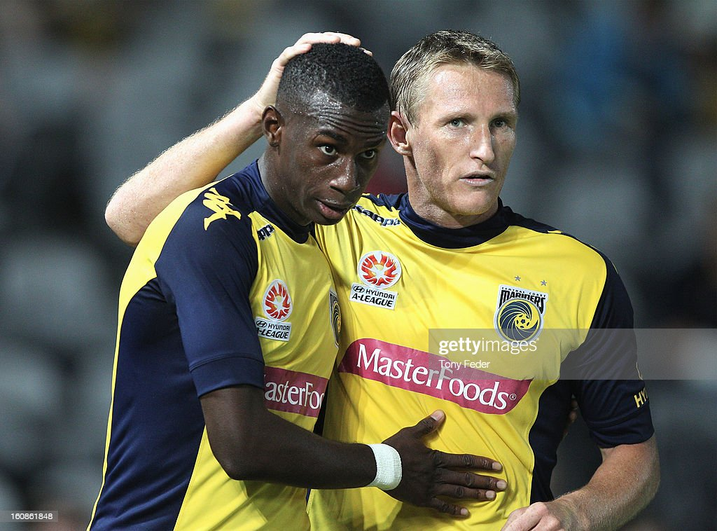 Bernie Ibini of the Mariners celebrates with teammate <a gi-track='captionPersonalityLinkClicked' href=/galleries/search?phrase=Daniel+McBreen&family=editorial&specificpeople=2229191 ng-click='$event.stopPropagation()'>Daniel McBreen</a> during the round 20 A-League match between the Central Coast Mariners and the Wellington Phoenix at Bluetongue Stadium on February 7, 2013 in Gosford, Australia.