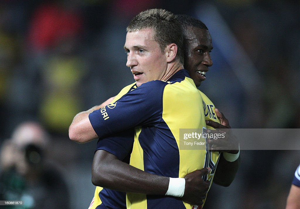 Bernie Ibini of the Mariners celebrates with teammate Mitchell Duke during the round 20 A-League match between the Central Coast Mariners and the Wellington Phoenix at Bluetongue Stadium on February 7, 2013 in Gosford, Australia.