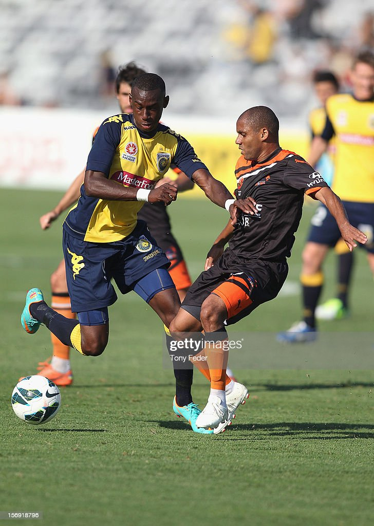Bernie Ibini of the Mariners contests the ball with his Brisbane oponent during the round eight A-League match between the Central Coast Mariners and the Brisbane Roar at at Bluetongue Stadium on November 25, 2012 in Gosford, Australia.