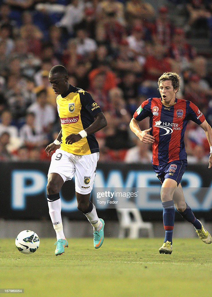Bernie Ibini of the Mariners controls the ball in front of Craig Goodwin of the Jetsduring the round ten A-League match between the Newcastle Jets and the Central Coast Mariners at Hunter Stadium on December 8, 2012 in Newcastle, Australia.