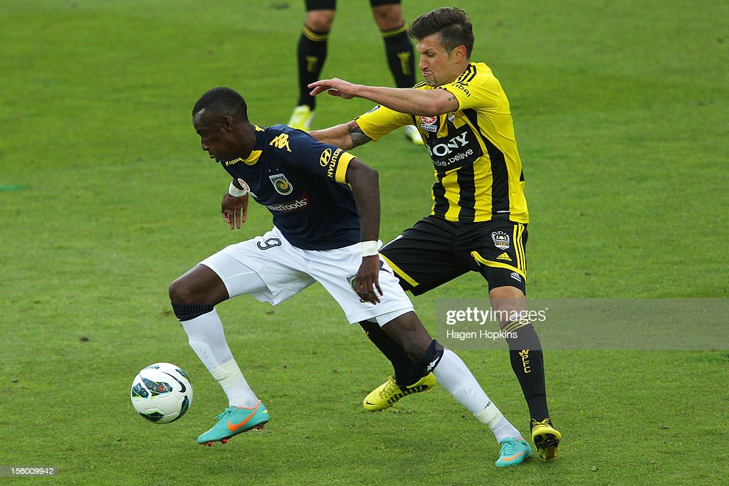 Bernie Ibini of the Mariners controls the ball under pressure from Vince Lia of the Phoenix during the round six A-League match between the Wellington Phoenix and the Central Coast Mariners at Westpac Stadium on November 11, 2012 in Wellington, New Zealand.
