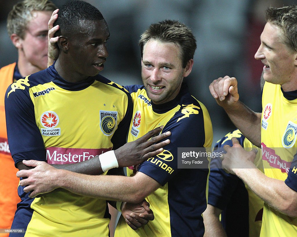Bernie Ibini of the Mariners is congratulated by team mates Joshua Rose and <a gi-track='captionPersonalityLinkClicked' href=/galleries/search?phrase=Daniel+McBreen&family=editorial&specificpeople=2229191 ng-click='$event.stopPropagation()'>Daniel McBreen</a> during the round 20 A-League match between the Central Coast Mariners and the Wellington Phoenix at Bluetongue Stadium on February 7, 2013 in Gosford, Australia.