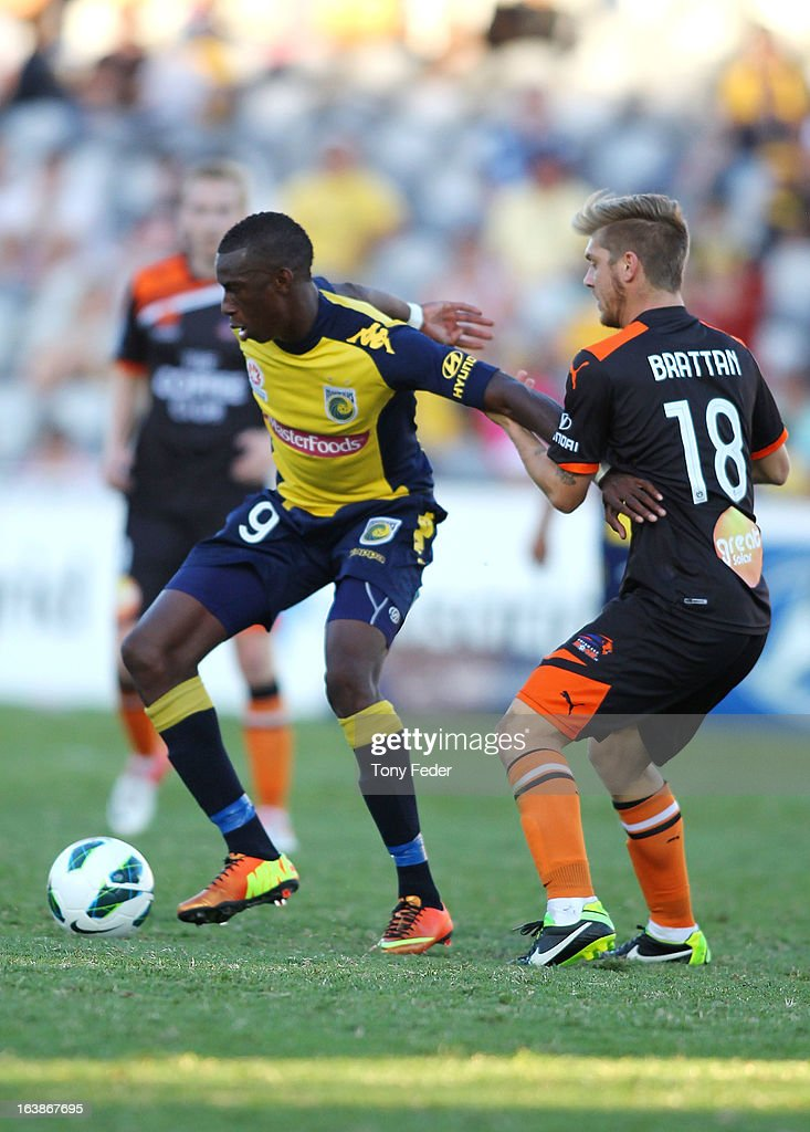 Bernie Ibini of the Mariners tries to break clear of Luke Brattan of Brisbane Roar during the round 25 A-League match between the Central Coast Mariners and the Brisbane Roar at Bluetongue Stadium on March 17, 2013 in Gosford, Australia.
