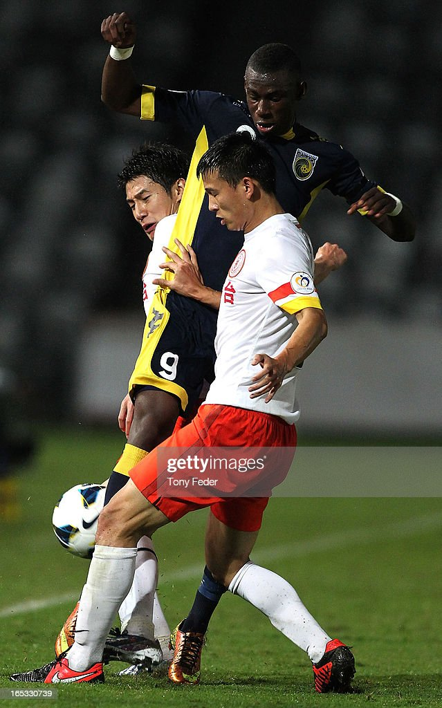 Bernie Ibinie of the Mariners is tackled by Guizhou defender Yu Hai during the AFC Asian Champions League match between the Central Coast Mariners and Guizhou at Bluetongue Stadium on April 3, 2013 in Gosford, Australia.
