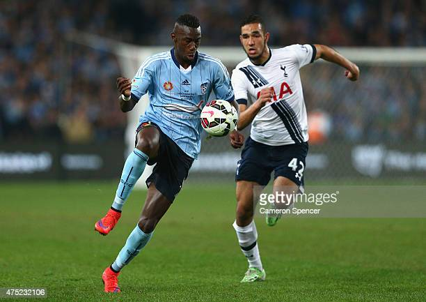 Bernie IbiniIsei of Sydney FC and Nabli Bentaleb of Hotspur contest the ball during the international friendly match between Sydney FC and Tottenham...