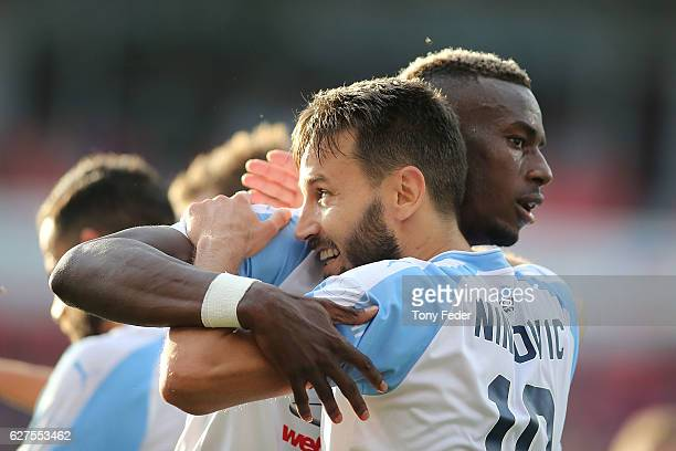 Bernie IbiniIsei of Sydney FC and team mate Milos Ninkovic celebrate a goal during the round nine ALeague match between the Newcastle Jets and Sydney...