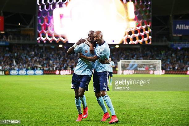 Bernie IbiniIsei of Sydney FC celebrates with Mickael Tavares after scoring the first goal during the ALeague Semi Final match between Sydney FC and...