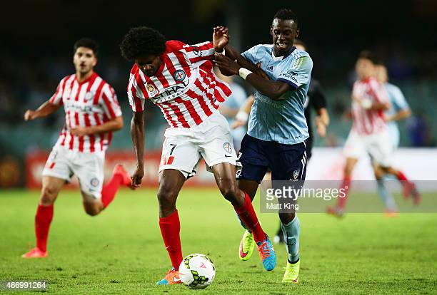 Bernie IbiniIsei of Sydney FC is challenged by Kew Jaliens of Melbourne City during the round 22 ALeague match between Sydney FC and Melbourne City...