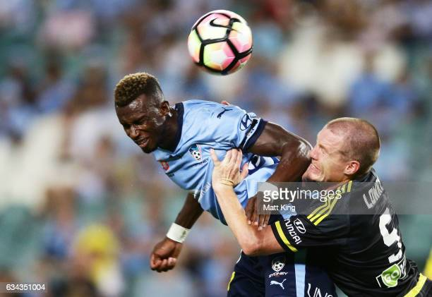 Bernie IbiniIsei of Sydney FC is challenged by Ryan Lowry of Wellington Phoenix during the round 19 ALeague match between Sydney FC and the...