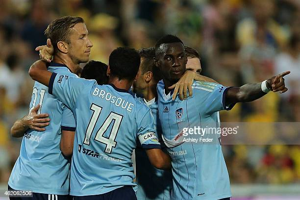 Bernie IbiniIsei of Sydney FC points to the Mariners crowd after his team scores a goal during the round 15 ALeague match between the Central Coast...