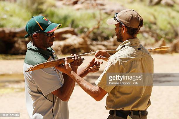 Bernie Lamont of Tasmania gets some advice on throwing a spear at the cultural day during the 20415 Imparja Cup on February 11 2015 in Alice Springs...