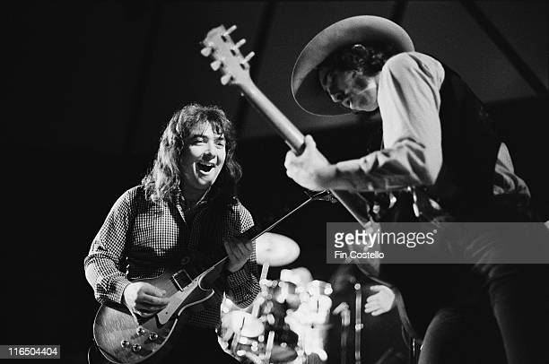 Bernie Marsden British rock guitarist alongside British rock guitarist Micky Moody on stage during a live concert performance by the band Whitesnake...