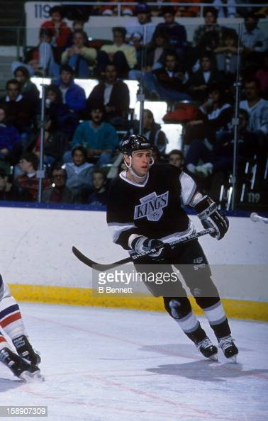Bernie Nicholls of the Los Angeles Kings skates on the ice during an NHL game against the New York Islanders on December 10 1988 at the Nassau...
