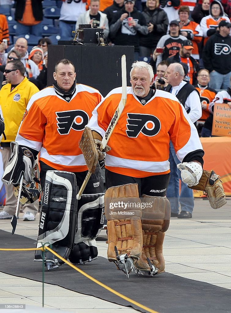 Bernie Parent #1 and Mark Laforest #33 of the Philadelphia Flyers take the ice to play against the New York Rangers during the 2012 Bridgestone NHL Winter Classic Alumni Game on December 31, 2011 at Citizens Bank Park in Philadelphia, Pennsylvania.