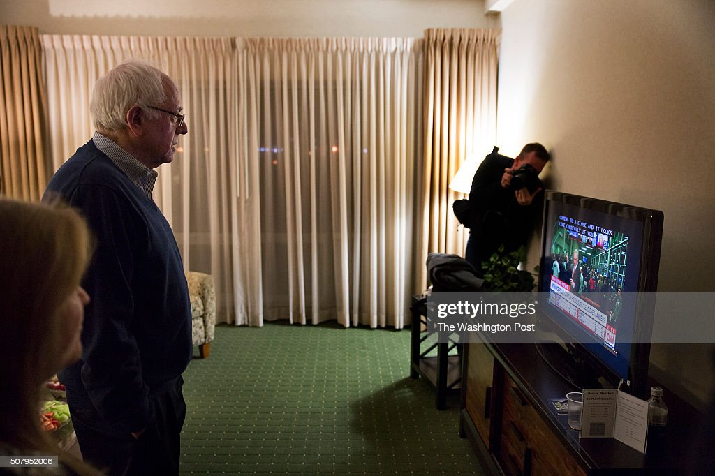 Bernie Sanders and if wife, Jane O'Meara Sanders, watch the results of the Caucus vote.