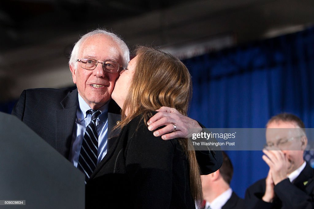 Bernie Sanders from his wife, Jane O'Meara Sanders, after speaking at Concord HS after winning NH.