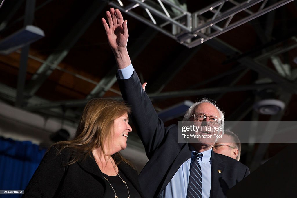 Bernie Sanders greets his supporters with his wife, Jane O'Meara Sanders, at Concord HS after winning NH.