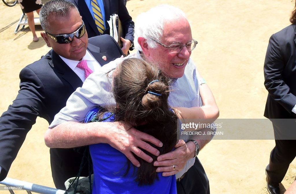 Bernie Sanders is greeted by a supporter following his speech during a rally at Lincoln Park in east Los Angeles, California on May 24, 2016, ahead of the June 7 Democratic vote for the state of California. / AFP / FREDERIC