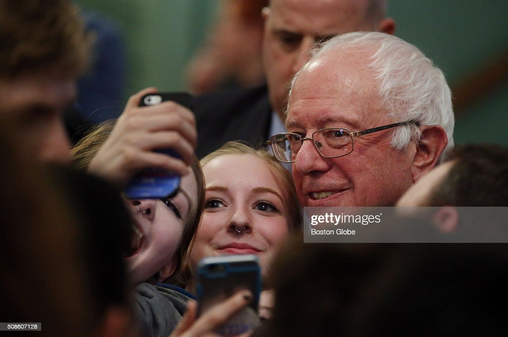 Bernie Sanders poses for pictures with members of the crowd following a 'Get Out the Vote' rally at Town Hall in Exeter, N.H. on Feb. 5, 2016.