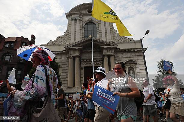 Bernie Sanders supporters are joined by other groups as they march towards FDR Park on the first day of the Democratic National Convention on July 25...