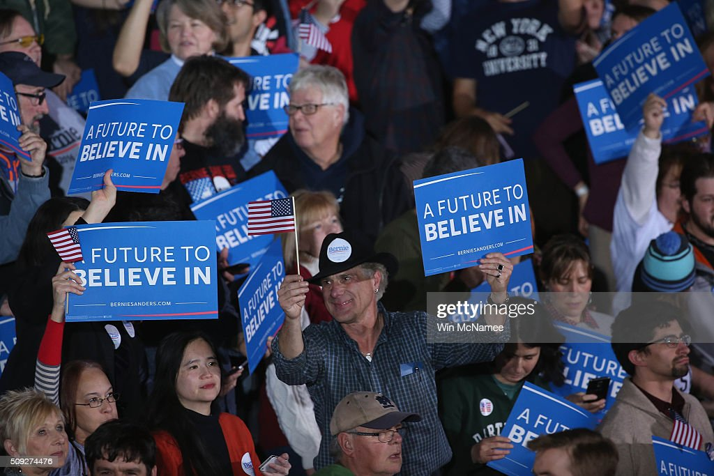 Bernie Sanders supporters cheer waiting for the candidat to come out at the candidate's New Hampshire Primary Night watch party February 9, 2016 in Concord, New Hampshire.