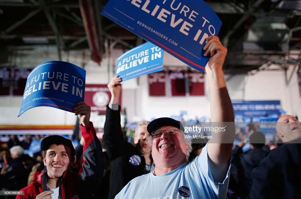 Bernie Sanders supporters react to television predictions of Sanders winning the Democratic New Hampshire Primary at the candidate's New Hampshire Primary Night watch party February 9, 2016 in Concord, New Hampshire.