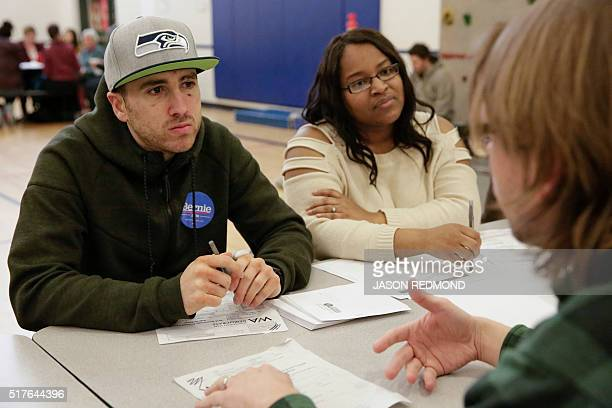 Bernie Sanders supporters Rudy Horn and Gevelle Cullen talk with other voters during Washington State Democratic Caucuses at Martin Luther King...