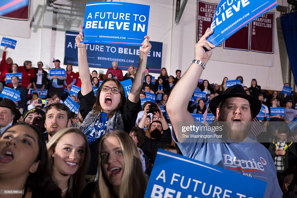Bernie Sanders supporters shout in excitement as he prepares to come out on stage after winning New Hampshire.
