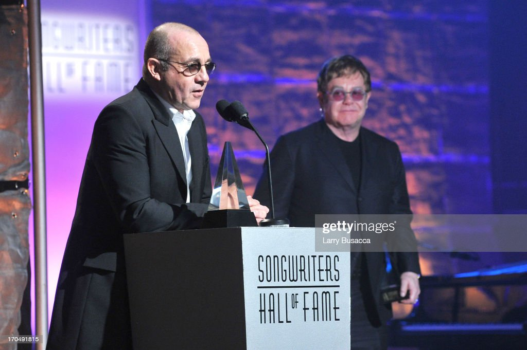 Bernie Taupin and Elton John accept the Mercer Award at the Songwriters Hall of Fame 44th Annual Induction and Awards Dinner at the New York Marriott Marquis on June 13, 2013 in New York City.