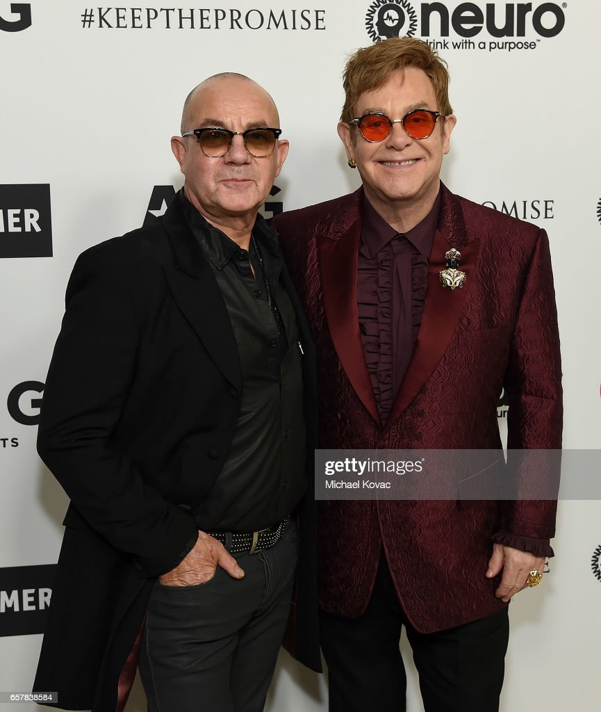Bernie Taupin (L) and Sir Elton John celebrate Elton John's 70th Birthday and 50-Year Songwriting Partnership with Bernie Taupin benefiting the Elton John AIDS Foundation and the UCLA Hammer Museum at RED Studios Hollywood on March 25, 2017 in Los Angeles, California.