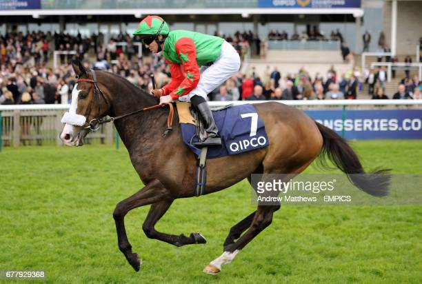 Bernie The Bolt ridden by jockey Pat Cosgrave goes to post in the Qipco Supporting British Racing Handicap