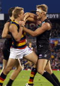 Bernie Vince of the Crows and Dean Brogan of the Power has an argument during the round 17 AFL match between the Port Adelaide Power and the Adelaide...