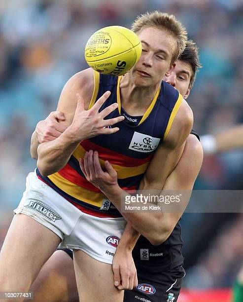 Bernie Vince of the Crows is tackled during the round 17 AFL match between the Port Adelaide Power and the Adelaide Crows at AAMI Stadium on July 25...