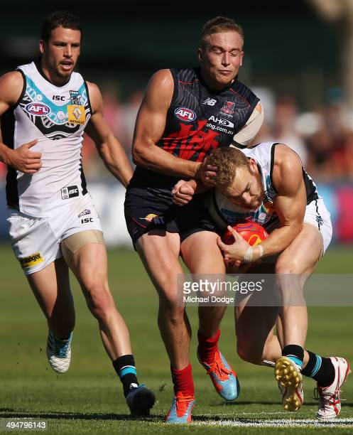 Bernie Vince of the Demons bumps into Andrew Moore of the Power during the round 11 AFL match between the Melbourne Demons and the Port Power at...