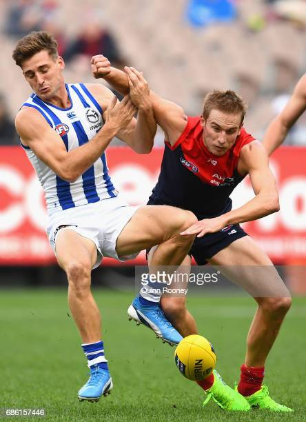 Bernie Vince of the Demons bumps Shaun Atley of the Kangaroos during the round nine AFL match between the Melbourne Demons and the North Melbourne...