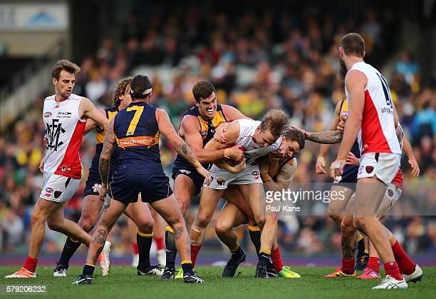 Bernie Vince of the Demons gets tackled by Scott Lycett and Jack Redden of the Eagles during the round 18 AFL match between the West Coast Eagles and...