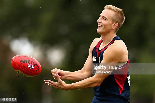 Bernie Vince of the Demons handballs during a Melbourne Demons AFL training session at Gosch's Paddock on April 8 2014 in Melbourne Australia