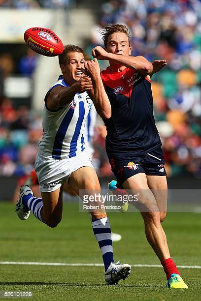 Bernie Vince of the Demons handballs during the round three AFL match between the North Melbourne Kangaroos and the Melbourne Demons at Blundstone...