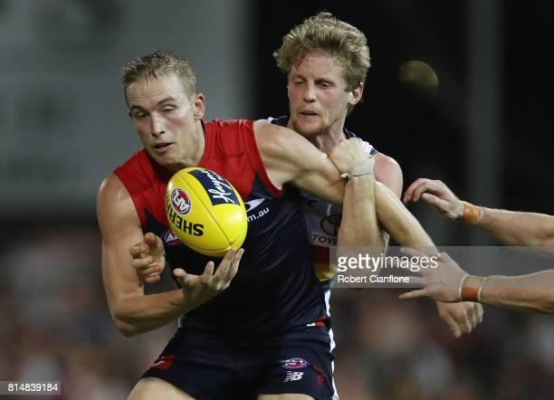 Bernie Vince of the Demons is challenged by Rory Sloane of the Crows during the round 17 AFL match between the Melbourne Demons and the Adelaide...
