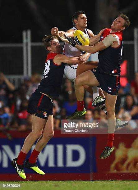 Bernie Vince of the Demons marks the ball in front of Mattew Pavlich of the Dockers during the round 16 AFL match between the Melbourne Demons and...