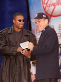 Bernie Williams and Mayor Rudolph Giuliani during Ticker Tape Parade for the New York Yankees 2000 World Series Champions at City Hall in New York NY...