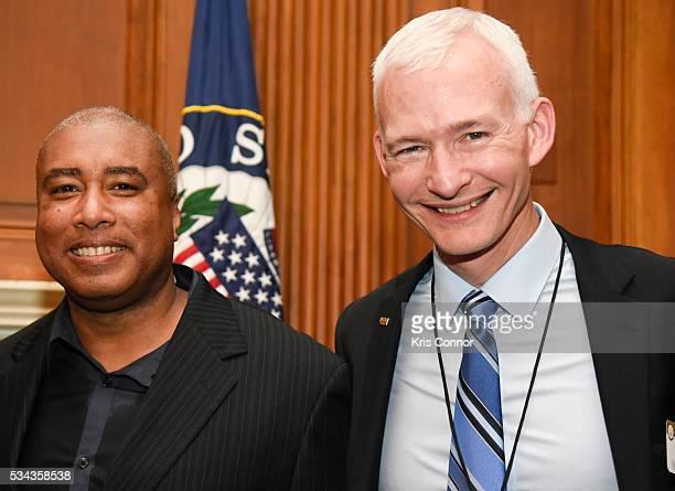 Bernie Williams and NAMM Chair Mark Goff pose with NAMM members during the CMA NAMM VH1 Congressional Reception for Music Education at the US Capitol...
