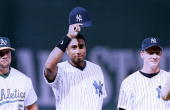 Bernie Williams of the American League waves to fans as he's introduced before the 1999 All Star Home Game at Fenway Park on July 131999 in Boston...