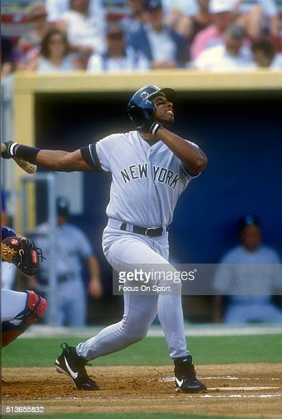 Bernie Williams of the New York Yankees bats against the Texas Rangers during a Major League Baseball spring training game circa 1991 at Municipal...