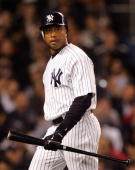 Bernie Williams of the New York Yankees holds a bat on the field during a game against the Boston Red Sox on May 9 2006 at Yankee Stadium in the...