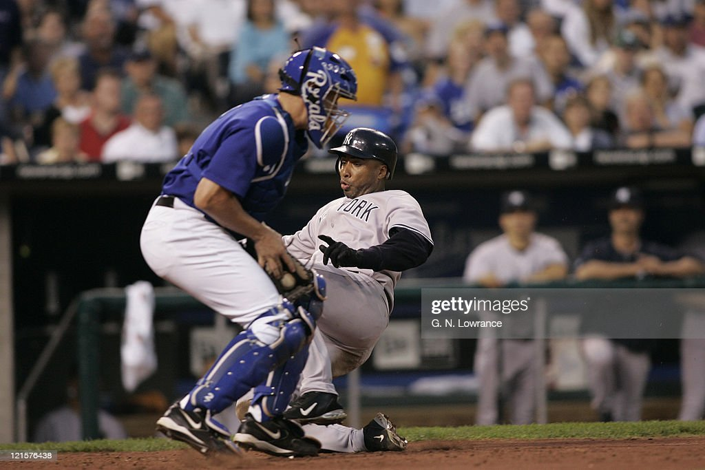 <a gi-track='captionPersonalityLinkClicked' href=/galleries/search?phrase=Bernie+Williams&family=editorial&specificpeople=175814 ng-click='$event.stopPropagation()'>Bernie Williams</a> of the New York Yankees scores ahead of the tag during a game against the Kansas City Royals at Kauffman Stadium in Kansas City, Mo. The Royals won the game 5-3.